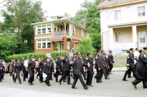 Police officers from different states participate in a memorial march for fallen officers Wednesday in Homewood. The visiting marchers are with the National Organization of Black Law Enforcement Executives, which held its national conference in Pittsburgh this week.