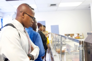 PBMF student Darronte Buckner tries to decide which flavor of ice cream he'd like from the Dream Cream Ice Cream shop on Aug. 3, 2014.