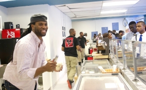 Thomas Jamison, owner and founder of Dream Cream Ice Cream, serves visiting PBMF students on Aug. 3, 2014.