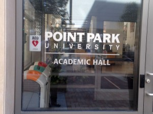 The Point Park logo on their front door of Academic Hall at Point Park University, on August 1, 2016. Photo taken by Kyle Smith.