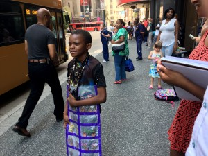 Haru Parker, center, attempts sell us his merchandise in Downtown Pittsburgh on Tuesday Aug. 2,2016. Photo by Sean Spencer