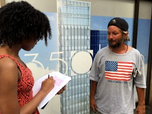 Ahmari Anthony, left, interviews a man who didn't want to be identified in Downtown Pittsburgh on Tuesday Aug. 2, 2016. Photo by Sean Spencer