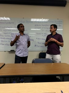 Tuhin Kun ,left,and his translator Kuman speak to the workshop students in Academic Hall at Point Park University on Tuesday Aug. 2, 2016. Photo by Sean Spencer