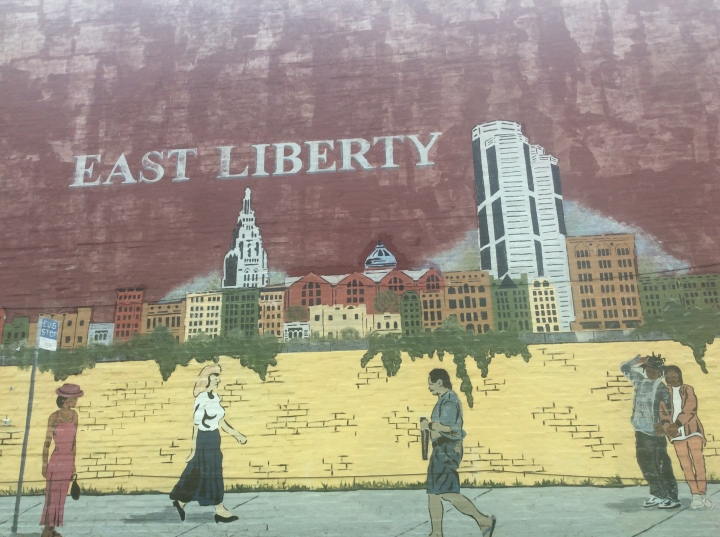 East Liberty mural shows people walking through the streets before their redevelopment.